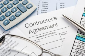 photo of calculator and contractor agreement
